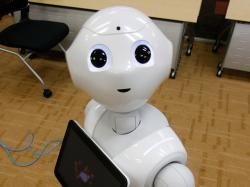 SoftBank Corp.'s new companion robot Pepper has cameras, lasers and infrared so it can detect human faces. It offers ardent attention, cool dance moves and small talk. Currently, it has no plans to harm humanity.