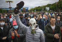 A man, wearing a mask to protect against coronavirus, attends a rally to support for potential presidential candidates in the upcoming presidential elections in Minsk, Belarus, Sunday, May 31, 2020.