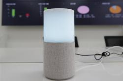 """SK Telecom's AI speaker Nugu built with an artificial intelligence called """"Aria"""" and a lamp that turns blue when processing voice commands for news, music and internet searches, is seen in Seoul, South Korea, on May 13, 2020"""