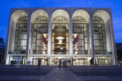 Pedestrians make their way in front of the Metropolitan Opera house at New York's Lincoln Center.