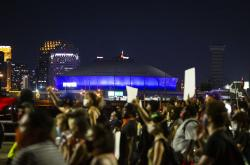 Protesters march over the Broad Street overpass in New Orleans.