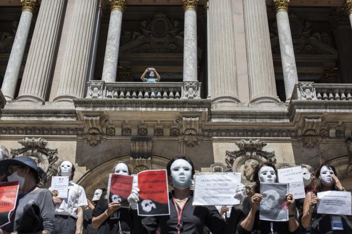French tourist guides stage a protest regarding the impact on their sector due to the coronavirus outbreak, outside the Opera Garnier in Paris, France, Thursday, July 30, 2020.