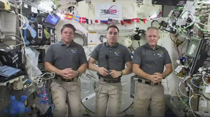 This photo provided by NASA shows from left, astronauts Bob Behnken, Chris Cassidy and Doug Hurley during an interview on the International Space Station on Friday, July 31, 2020