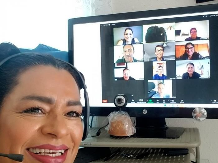 This photo provided by Adriana Brindis of Santa Ana, Calif., shows her during an online workshop to train people to perform contact tracing in immigrant communities, on Wednesday, Aug. 12, 2020