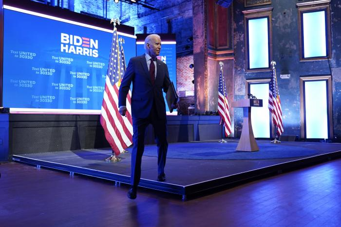 Democratic presidential candidate former Vice President Joe Biden walks off stage after giving a speech on the Supreme Court at The Queen Theater.