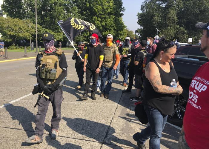 Members of the extremist right-wing group the Proud Boys arrive in Salem, Ore.