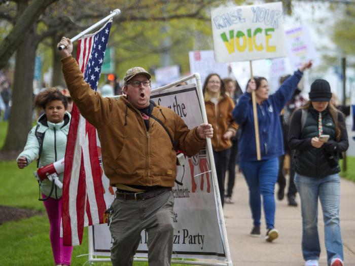 Joining thousands gathered outside the State Capitol, opponents of a bill to repeal Connecticut's religious exemption for required school vaccinations marches down Capitol Avenue before the State Senate voted on legislation, Tuesday, April 27, 2021, in Hartford, Conn.