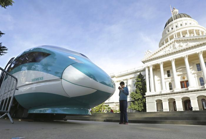 In this Feb. 26, 2015, file photo, a full-scale mock-up of a high-speed train is displayed at the Capitol in Sacramento, Calif.